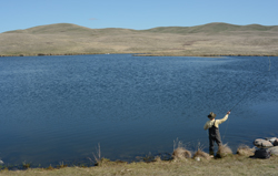 A man fishes at a reservoir in southern Alberta but how long will he be allowed to do that?