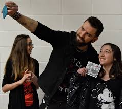 Shelby Dabbs eagerly awaits her turn to talk personally with performer, Robb Nash and maybe snap a selfie with the growing star like Brittany Bowthorpe did. Nash stayed after his concert was done to talk with the students at the Coronation school on Feb. 12.